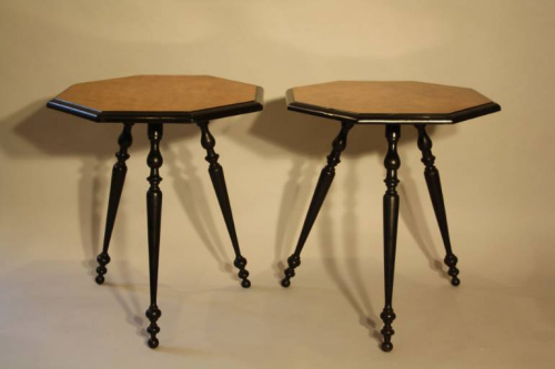 A pair of ebonised and birds eye maple, octagonal tripod tables, c1870