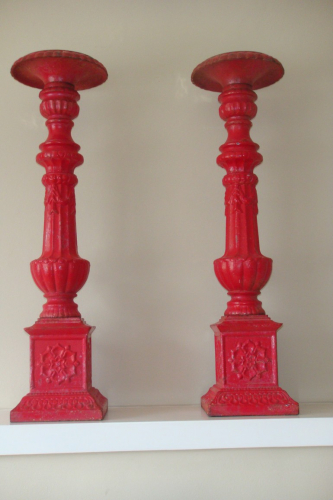 A pair of 19thC Victorian red painted cast iron candlesticks