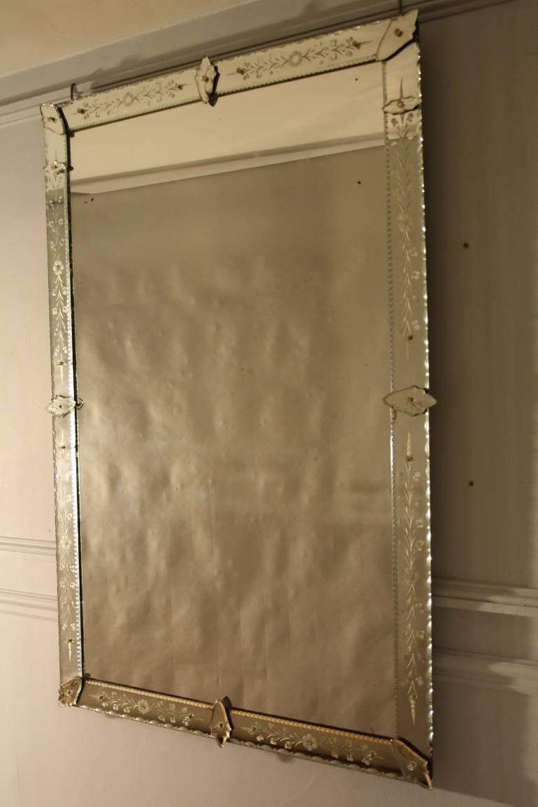 C19th rectangular French Venetian mirror with etched floral details.