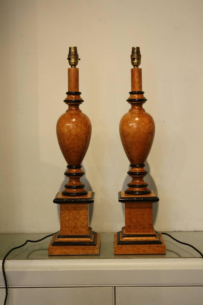 2 pairs of faux walnut and ebonised table lamps