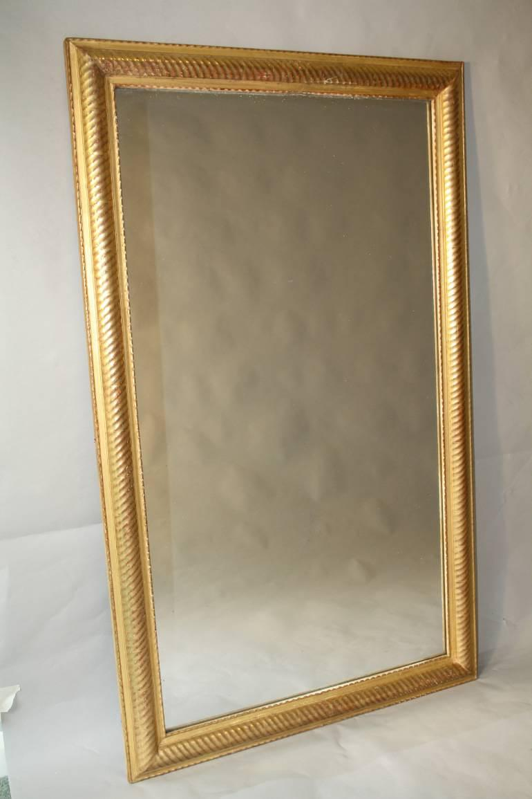 Gold leaf ripple/rope twist framed mercury glass mirror