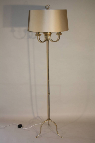A silver and gold bamboo floor light