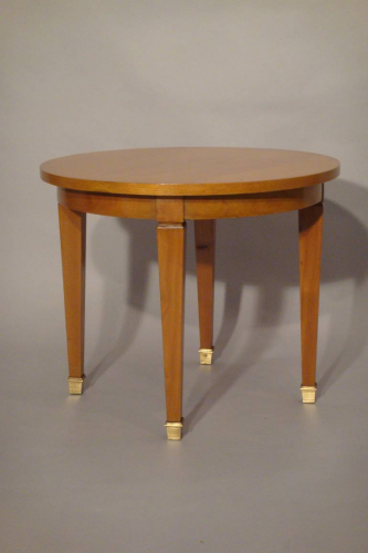 A small beechwood occasional table, attributed to Jacques Adnet, French c1950