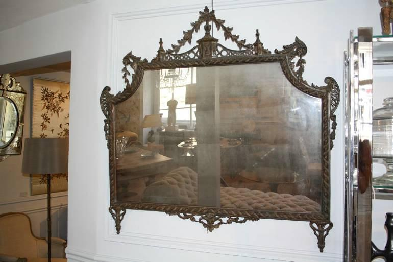 Carved wood and polychrome over mantle mirror