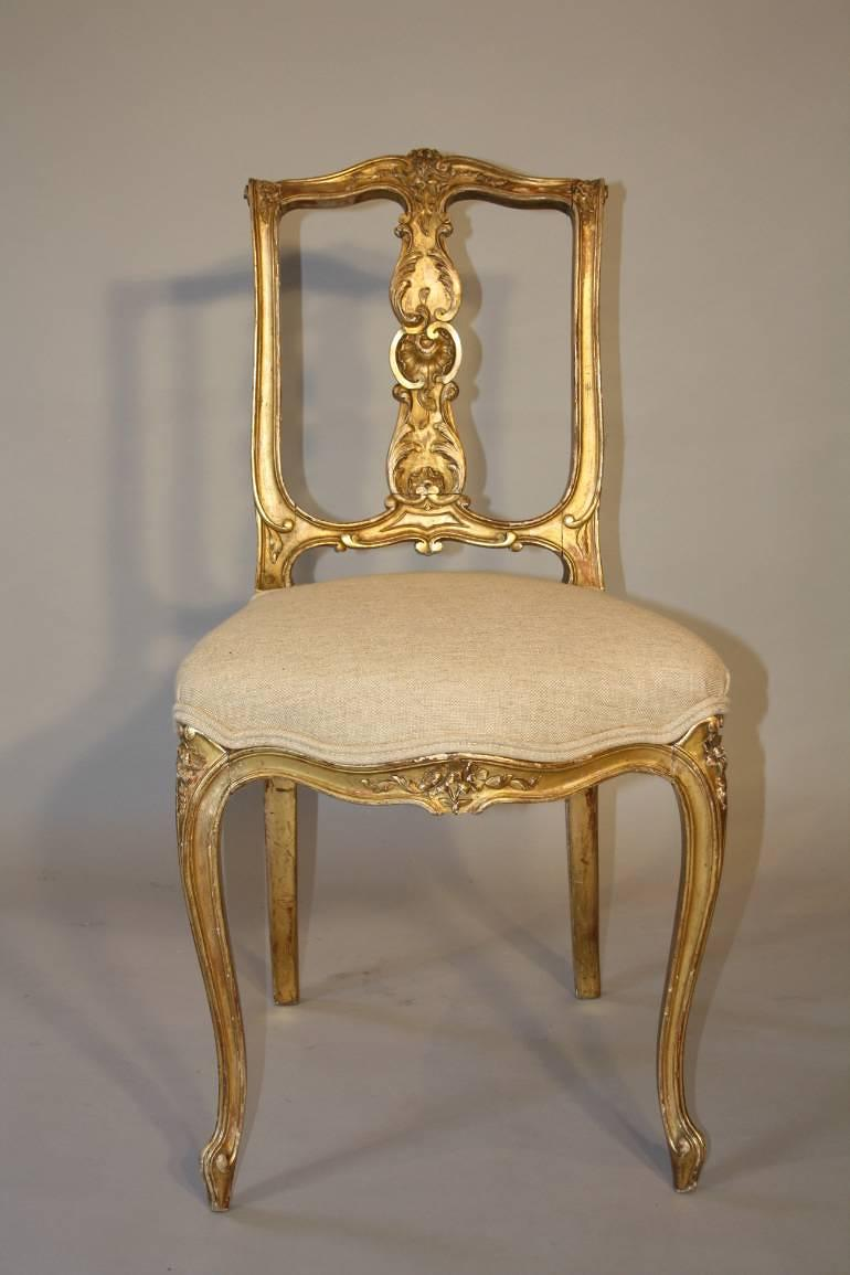 Carved gilt wood chair, French C19th