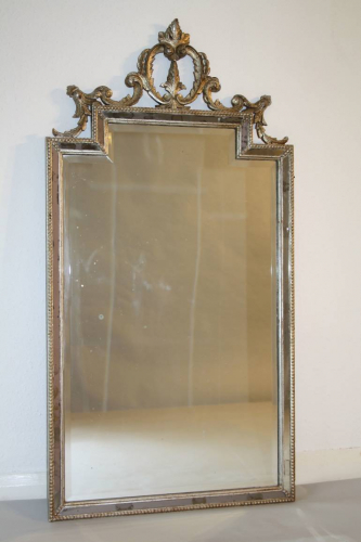 Carved wood silver overmantle mirror