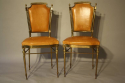 A pair of gilt brass and leather chairs - picture 3