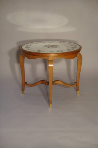 Beautiful French 1940`s carved walnut occasional table with original verre eglomise top and sabot feet.
