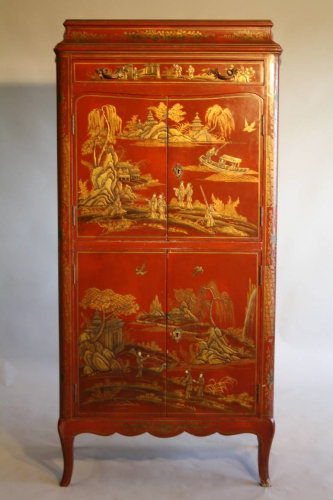 A 1920`s red chinoiserie tall cabinet