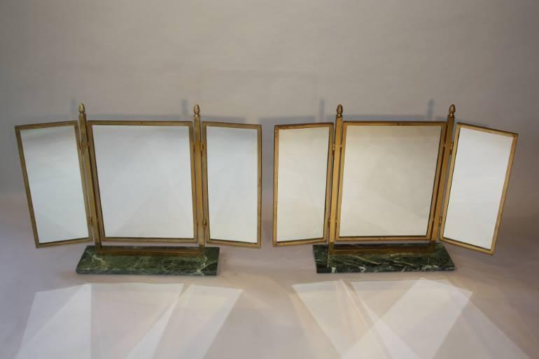 A pair of Art Deco style gilt brass triptych dressing table mirrors