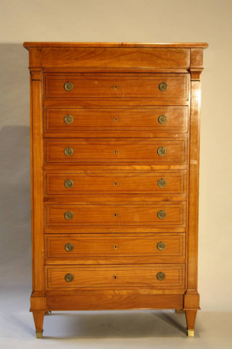 An elegant fruitwood tallboy, French c1940