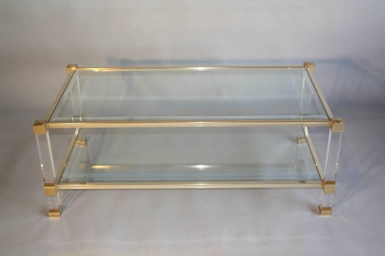 A PAIR of Pierre Vandel two tier glass and lucite coffee tables. French c1970