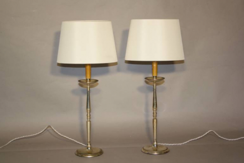 A pair of silver table lamps