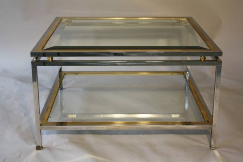 A square silver and gold two tier coffee table