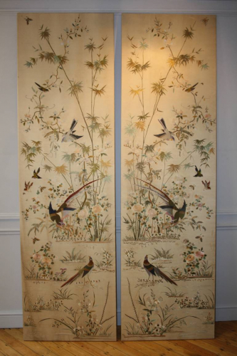 A pair of hand embroidered silk panels, c1900
