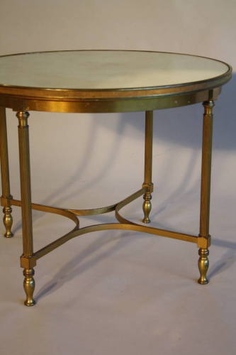A circular brass and mirror glass occasional table, French c1950