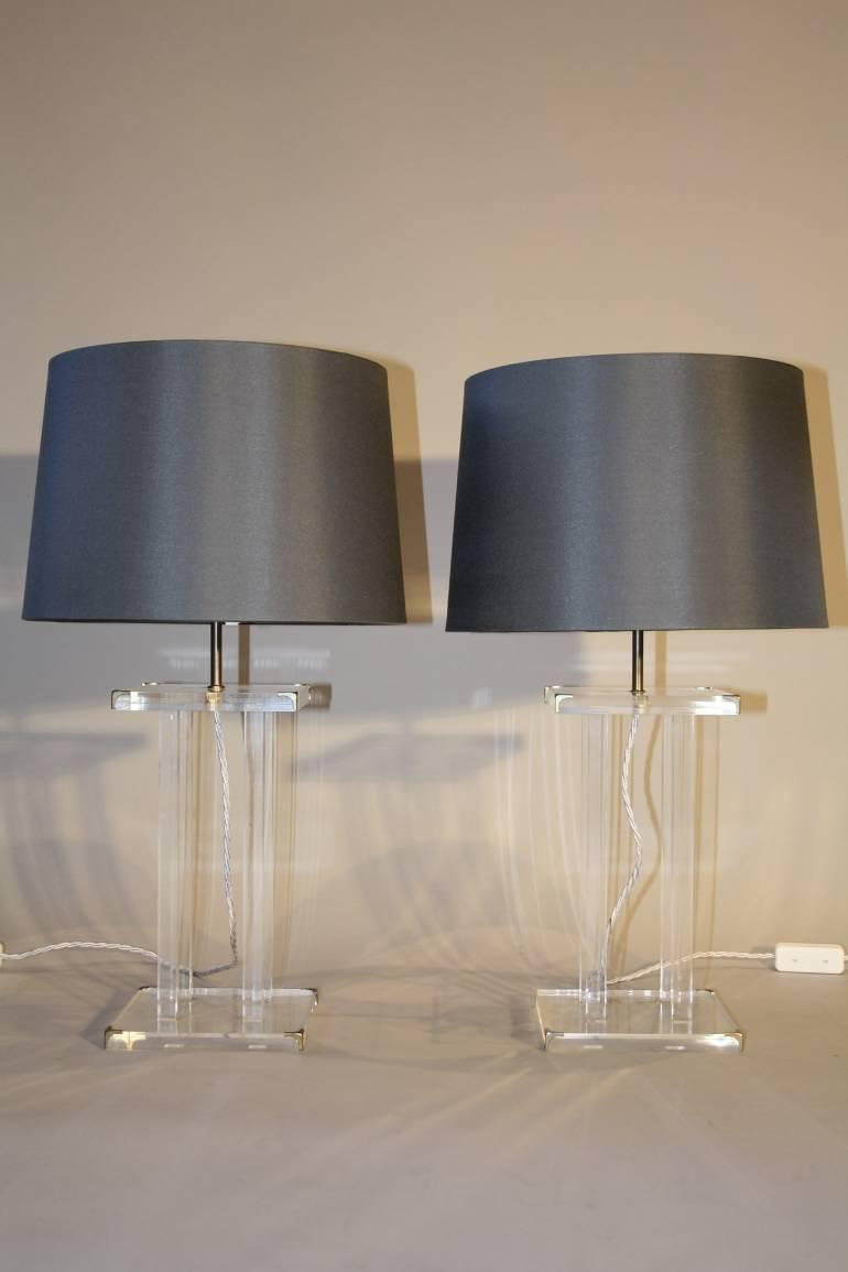 A pair of lucite table lamps, French c1970