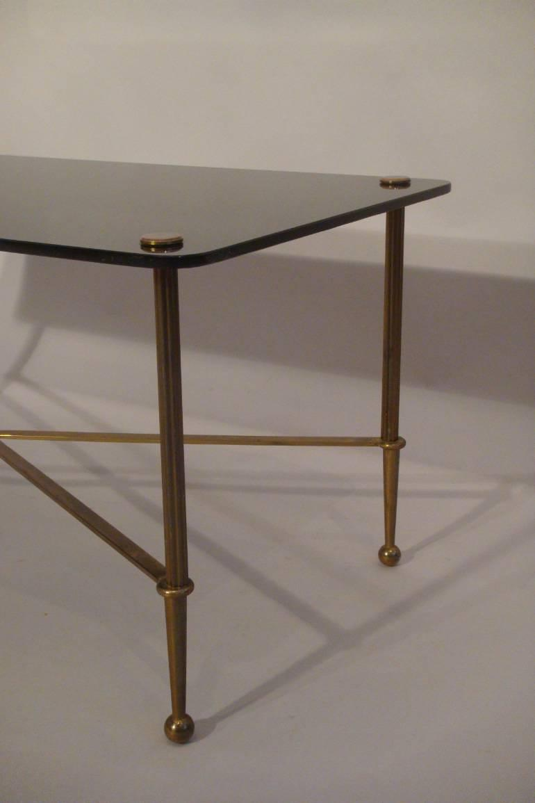 Rectangular black vitrolite glass and gold metal occasional table, French c1950