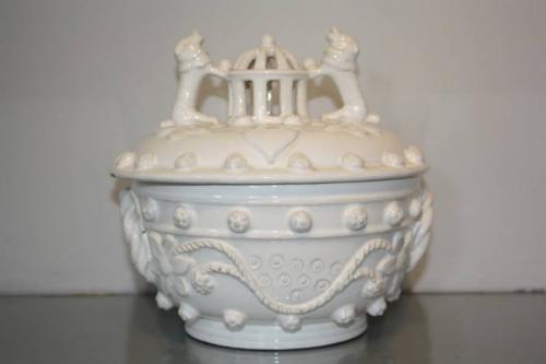 A 19thC white glazed ceramic pot with lid