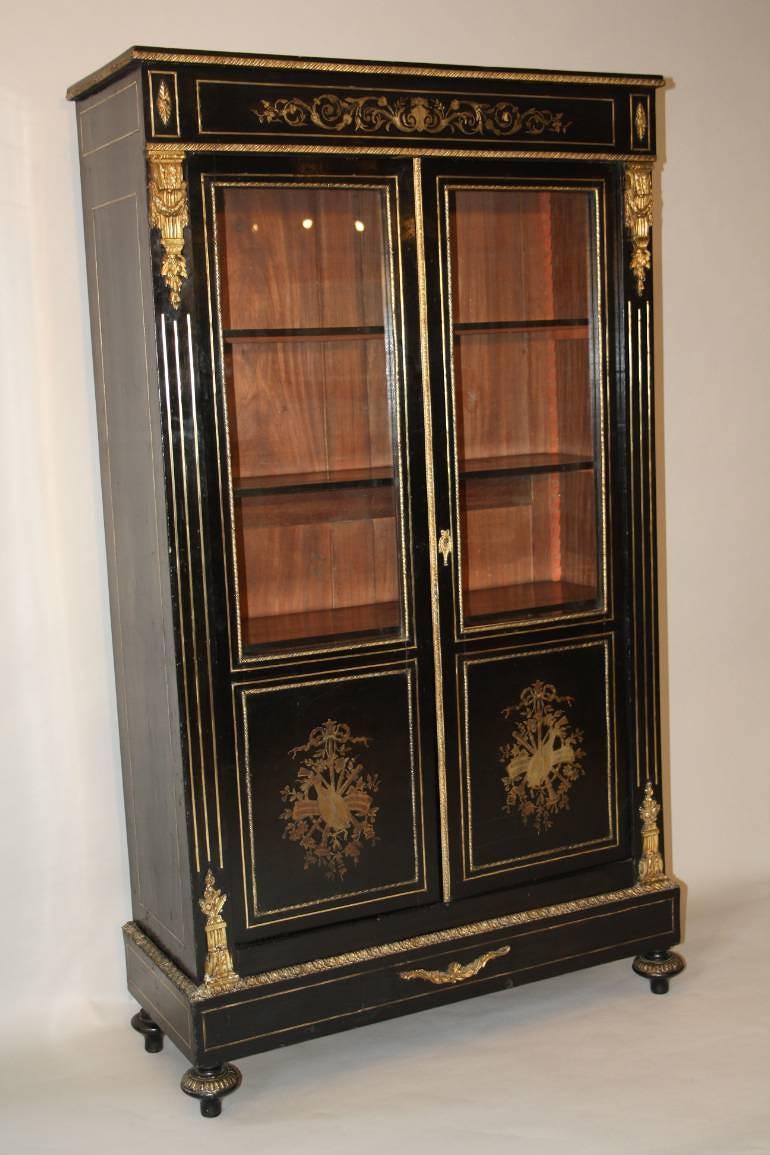 Napoleon III ebony veneer and ormolu cabinet