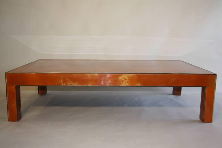 Vintage 1970`s orange and gold lacquered coffee table.