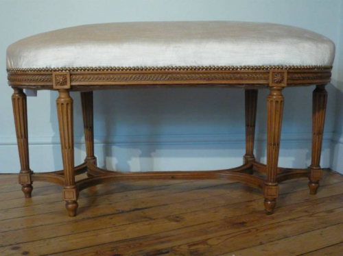 Beautifully carved wood Louis Philippe seat. French. Re upholstered in cream velvet