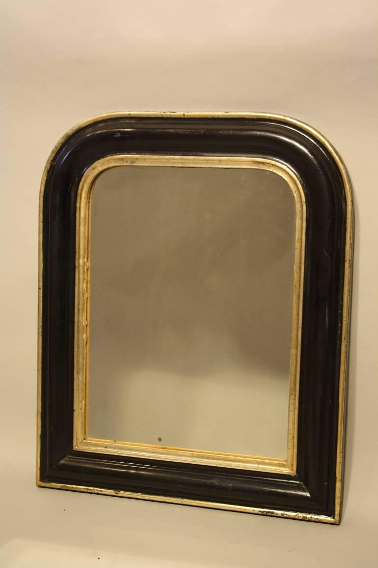 Petite black and gold archtop mirror