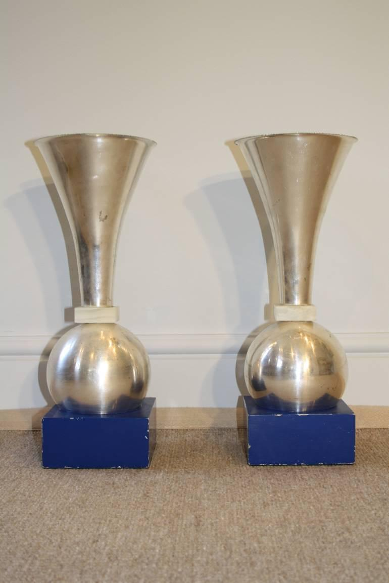 A pair of early modernist silver metal and onyx uplights on painted blue base, Italian c1930