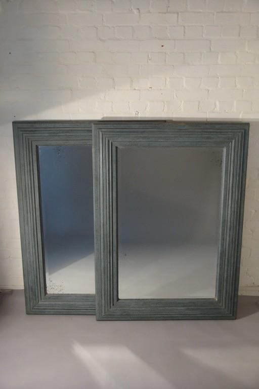 A pair of large pale blue mirrors made from 19thC architrave and fitted with antique bevelled mirror glass