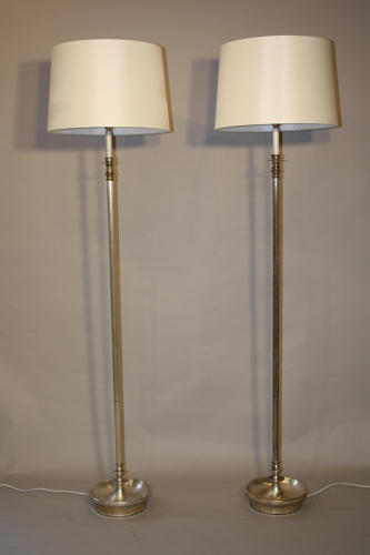Pair a silver floor lamps