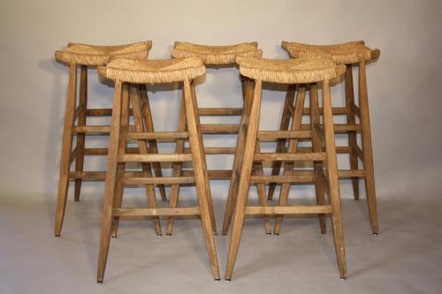 5 Oak and rattan bar stools