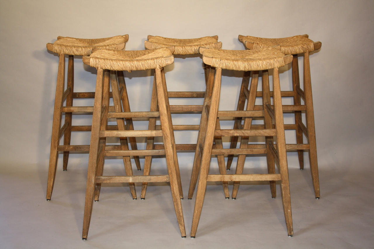 5 Oak and rattan bar stools