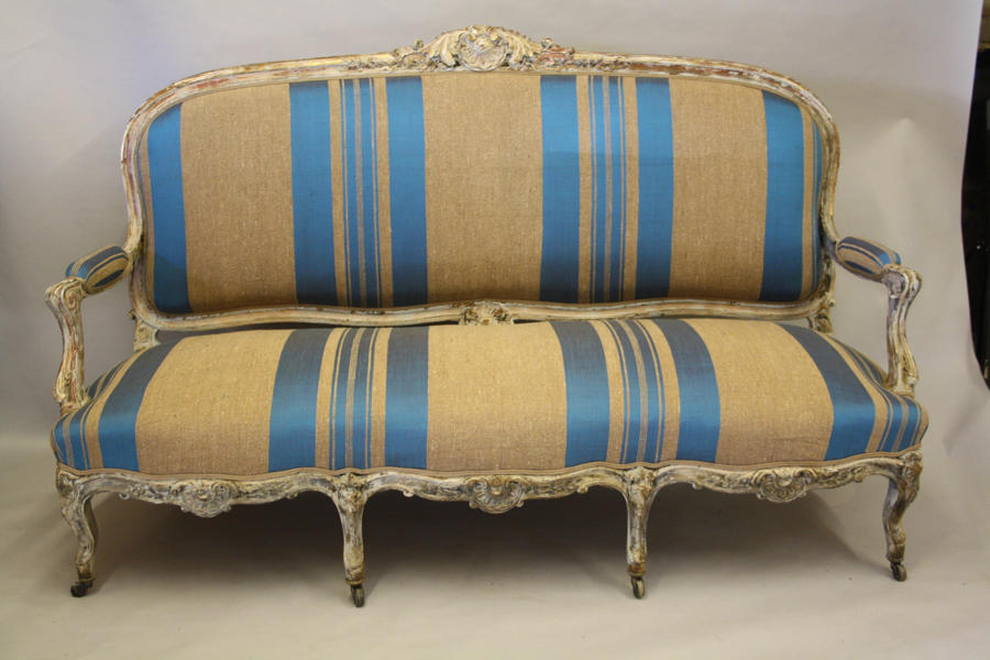 Carved and painted framed Louis XV sofa