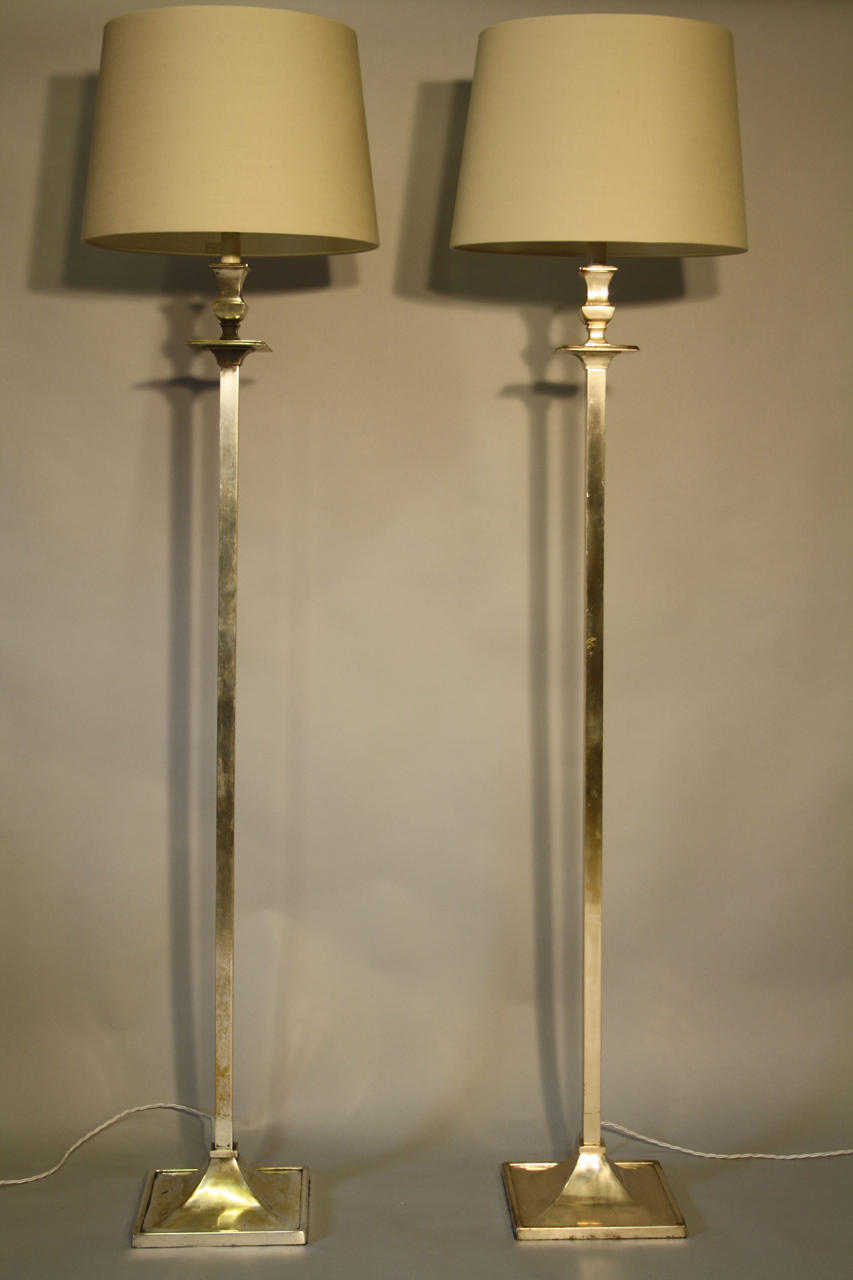 Pair of silver square base floor lamps
