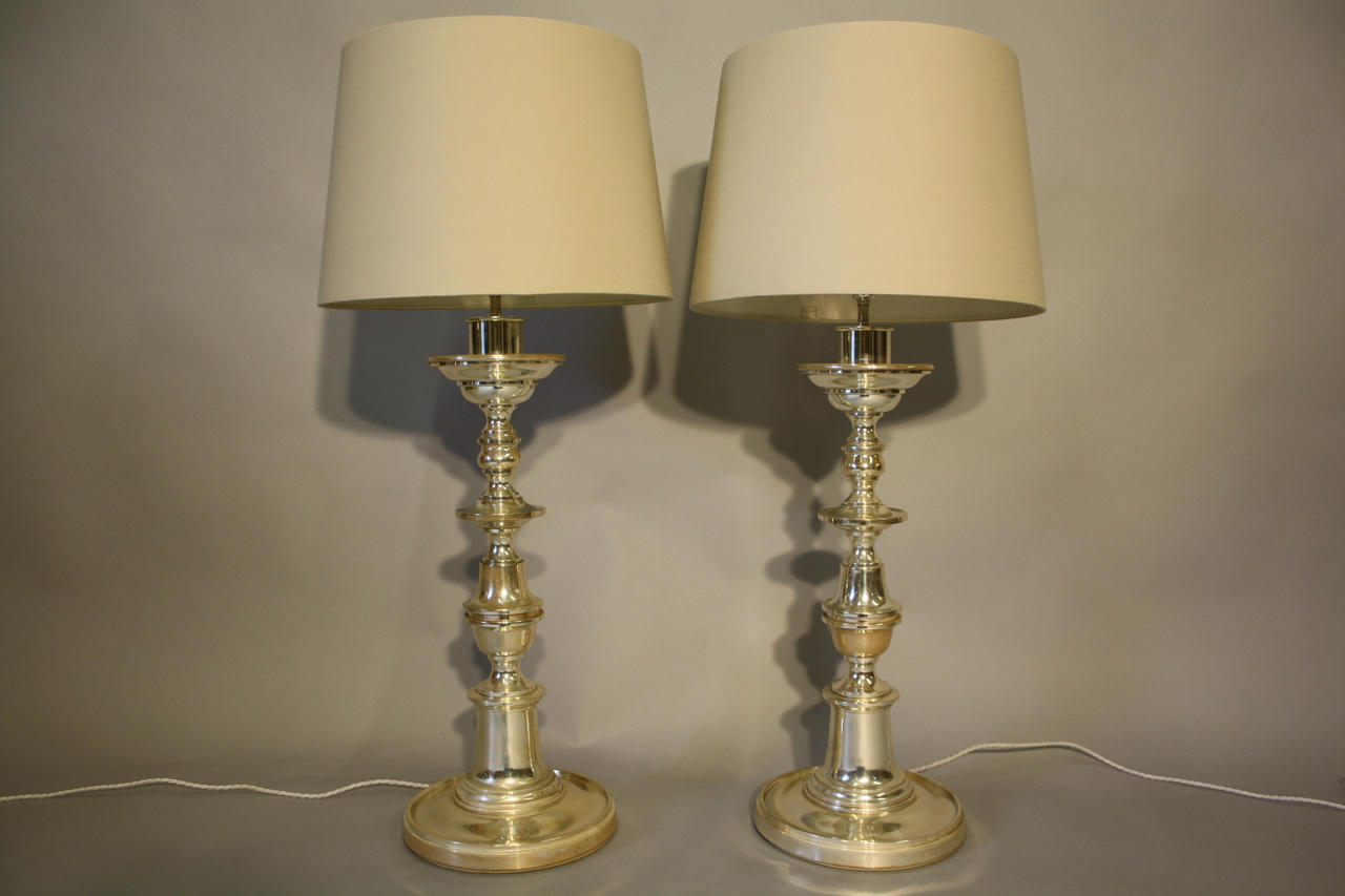 Pair of tall silver table lights