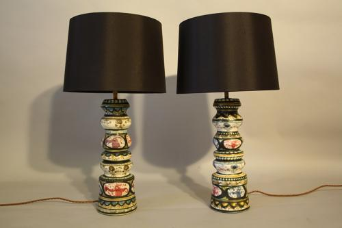 A pair of folksy painted ceramic table lamps