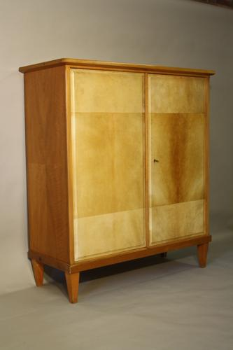 Tall walnut and parchment cupboard