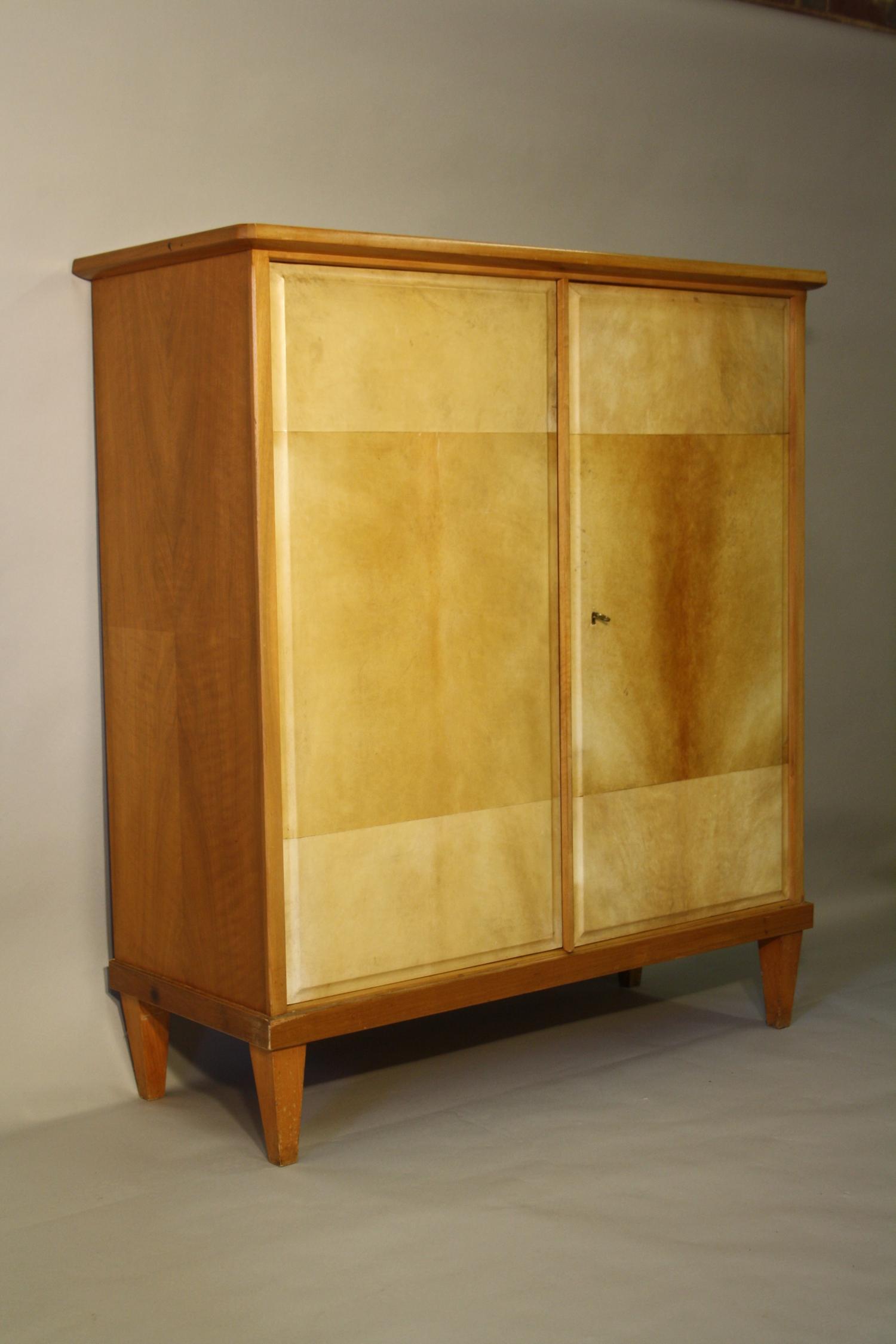 Tall walnut and parchment cupboard