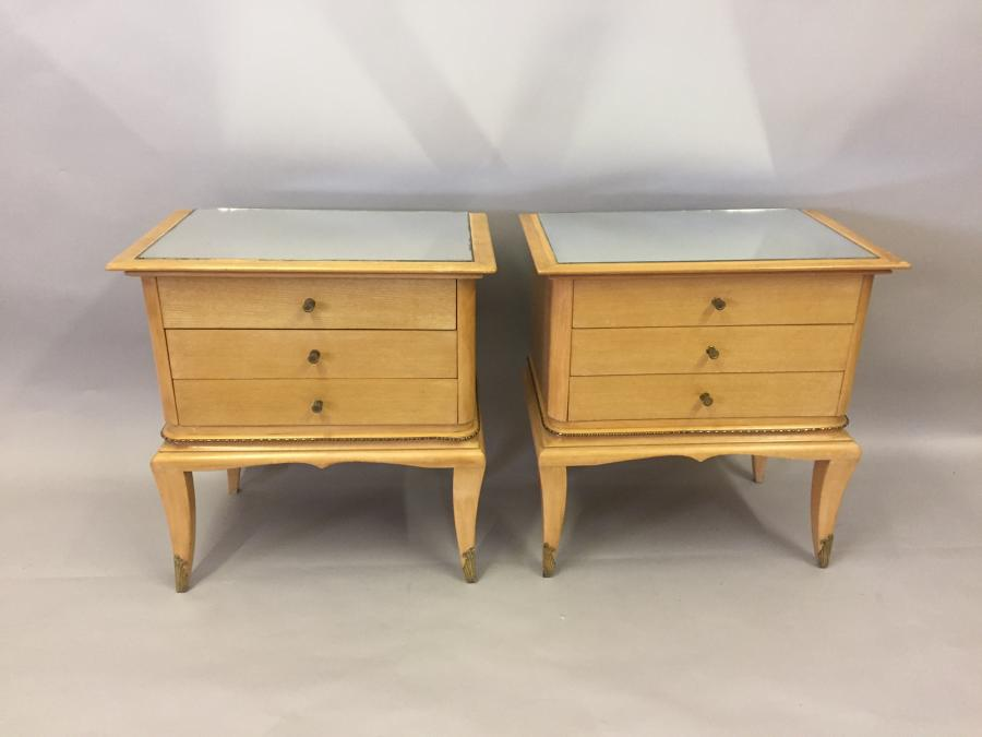 A pair of pale fruitwood side tables