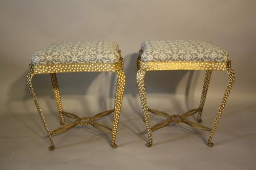 A pair of gilt metal stools