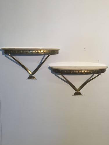 A pair of gilt metal wall side consoles