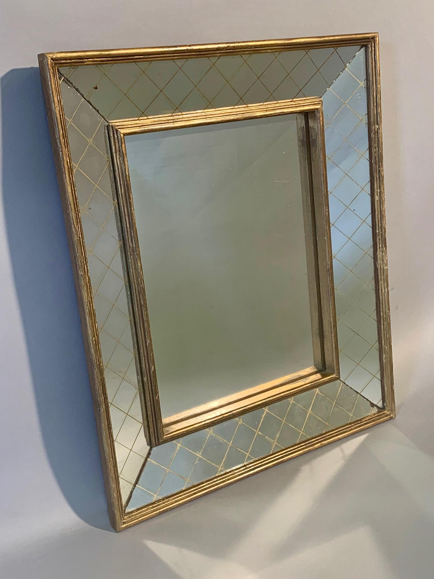 Gilt gesso criss cross frame mirror