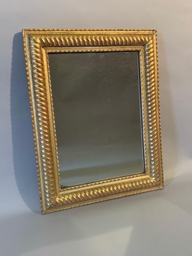 Small French gilt gesso ridge framed mirror.