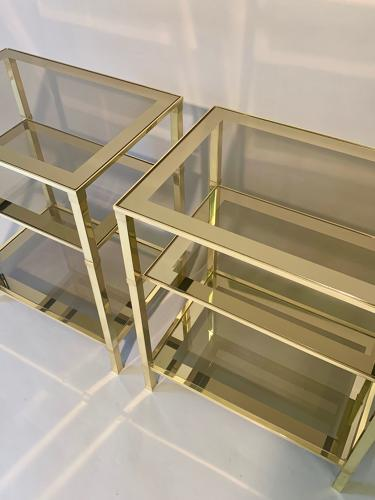 Pair of three tier brass side tables