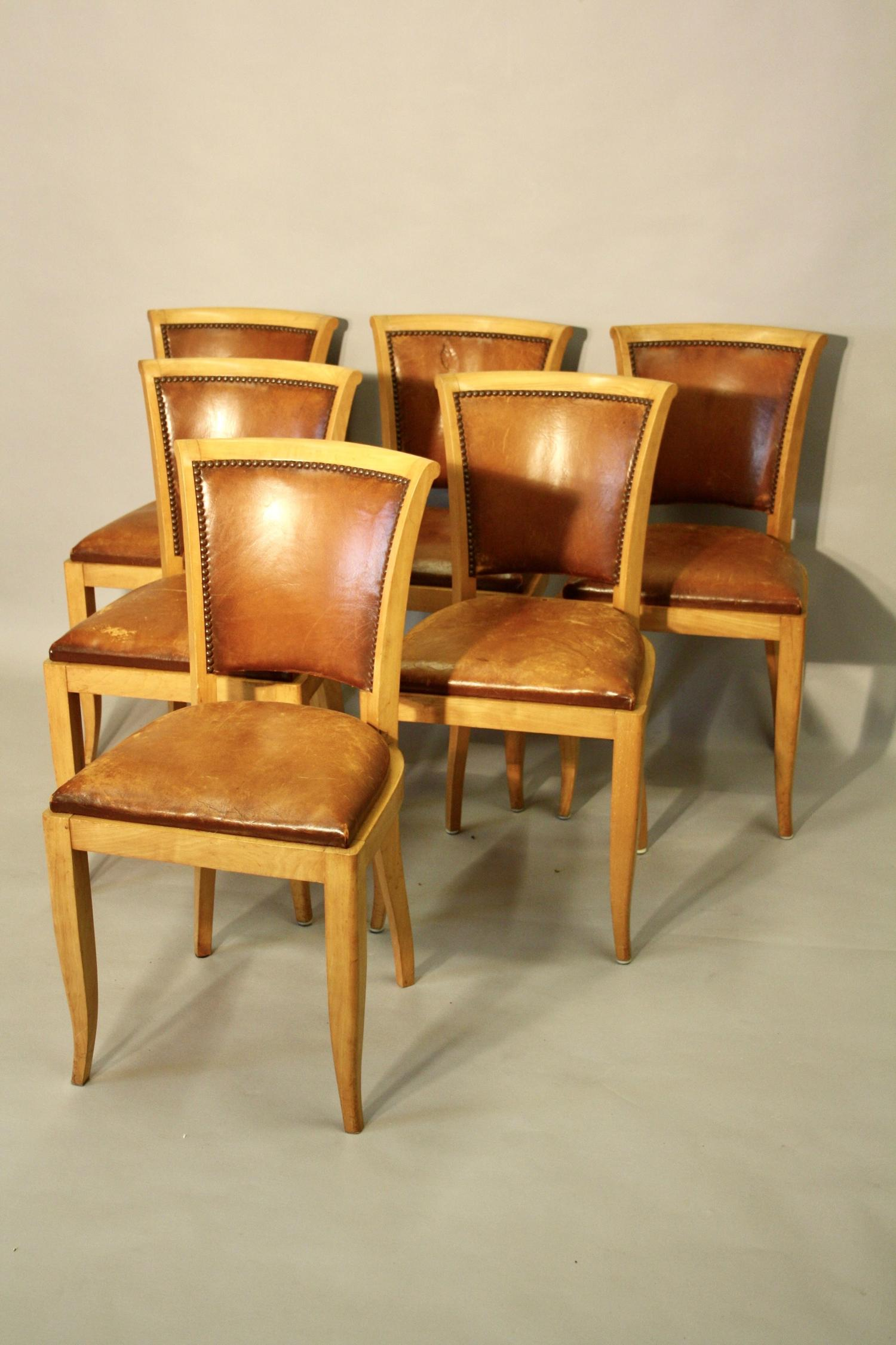 Set of six tan leather and pale beech dining chairs