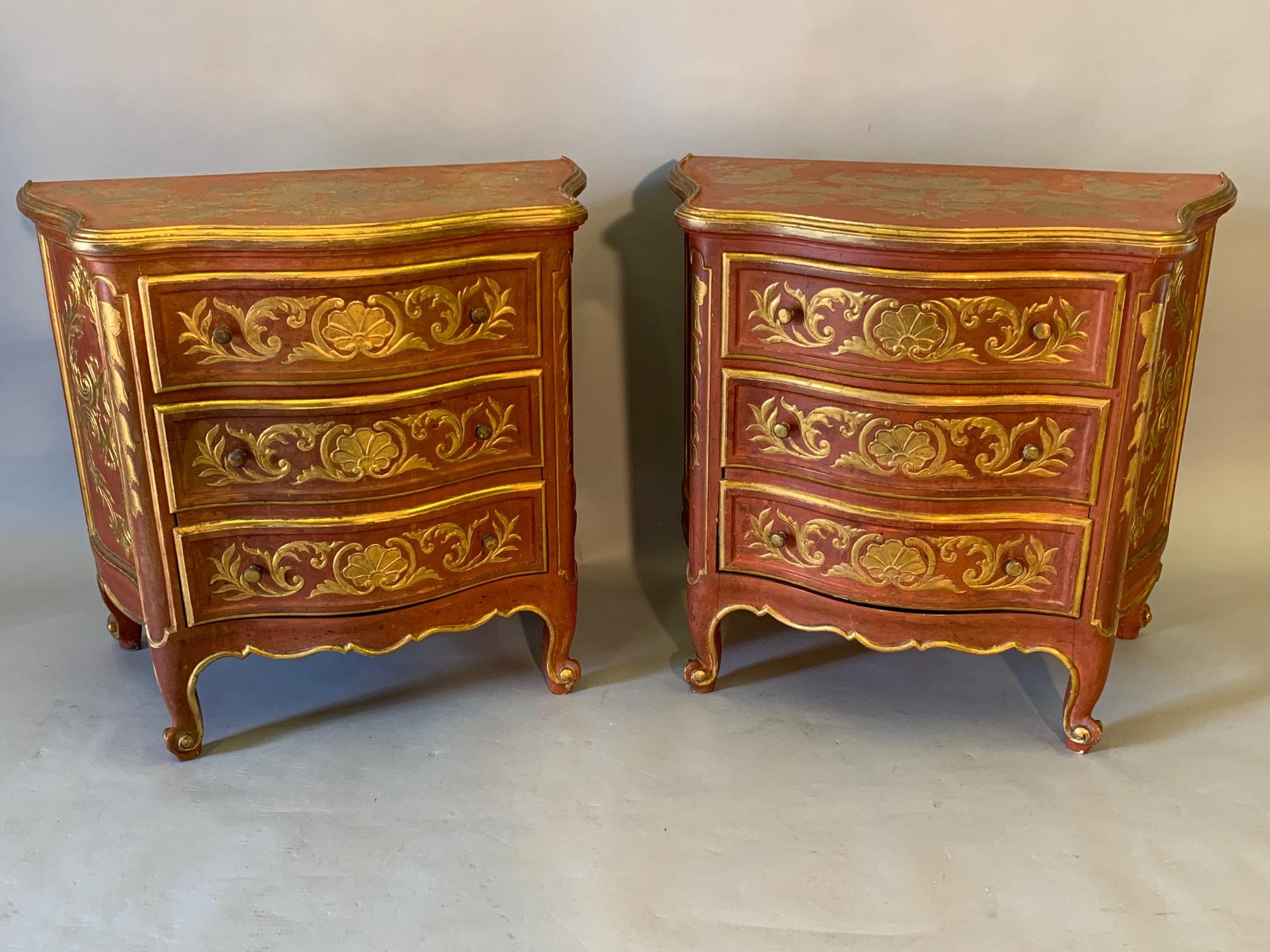 A pair of red ochre and gilt serpentine side cabinets