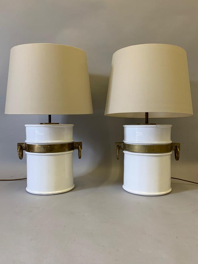 A pair of white glazed ceramic table lamps