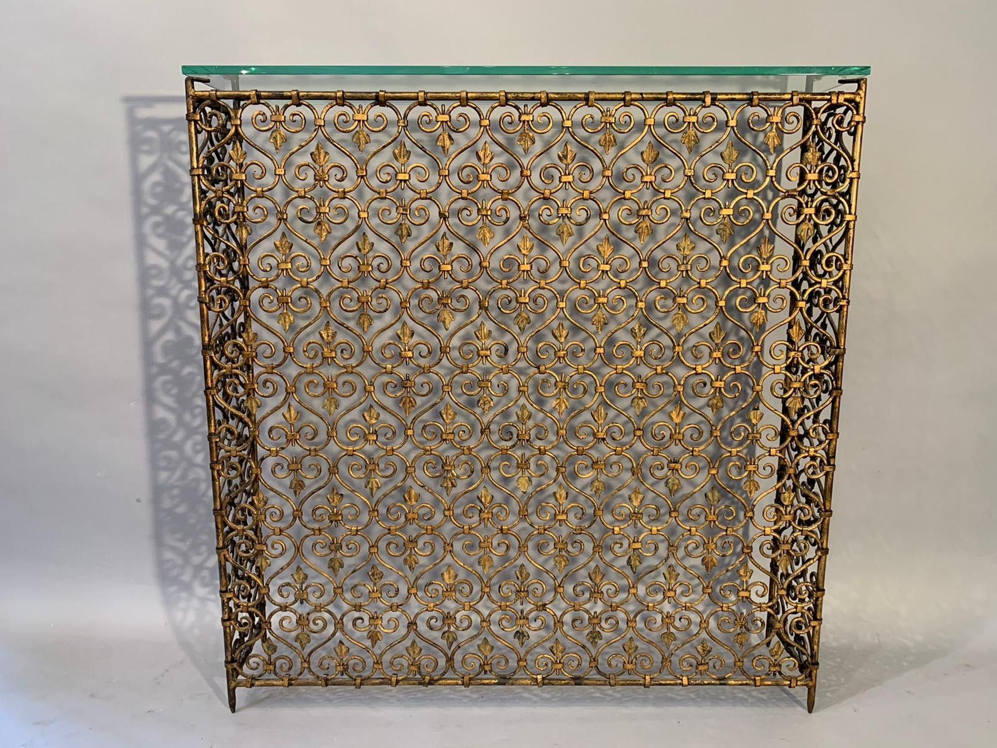 Gilt metal scroll console/radiator cover
