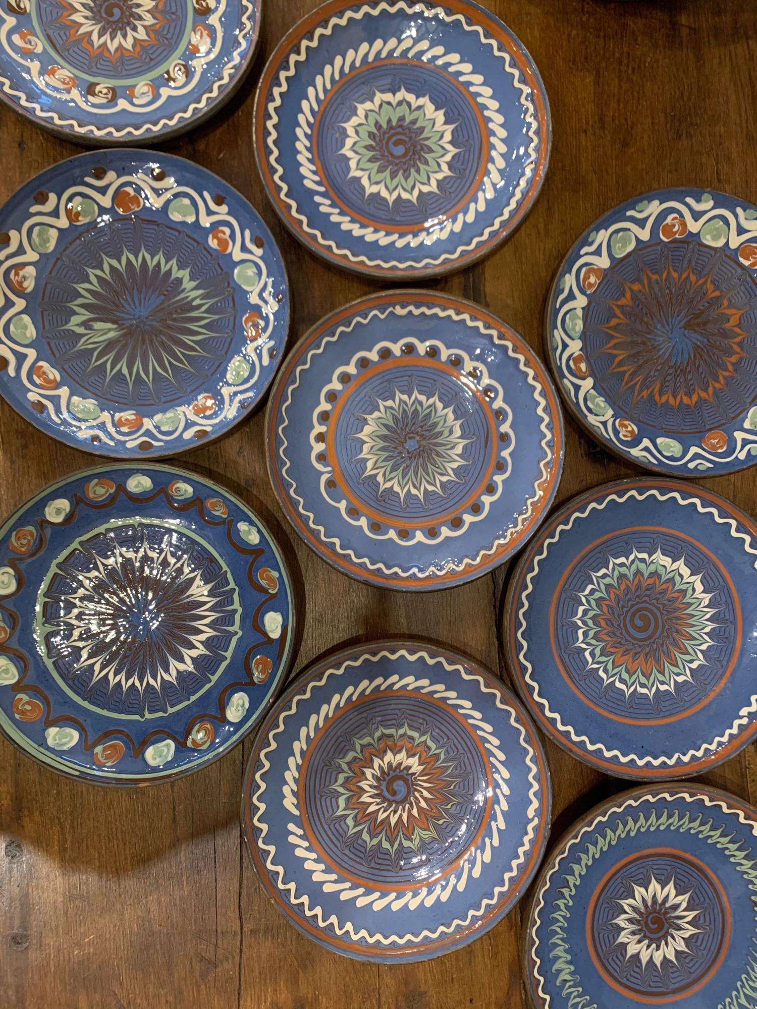A set of 10 Romanian hand decorated plates