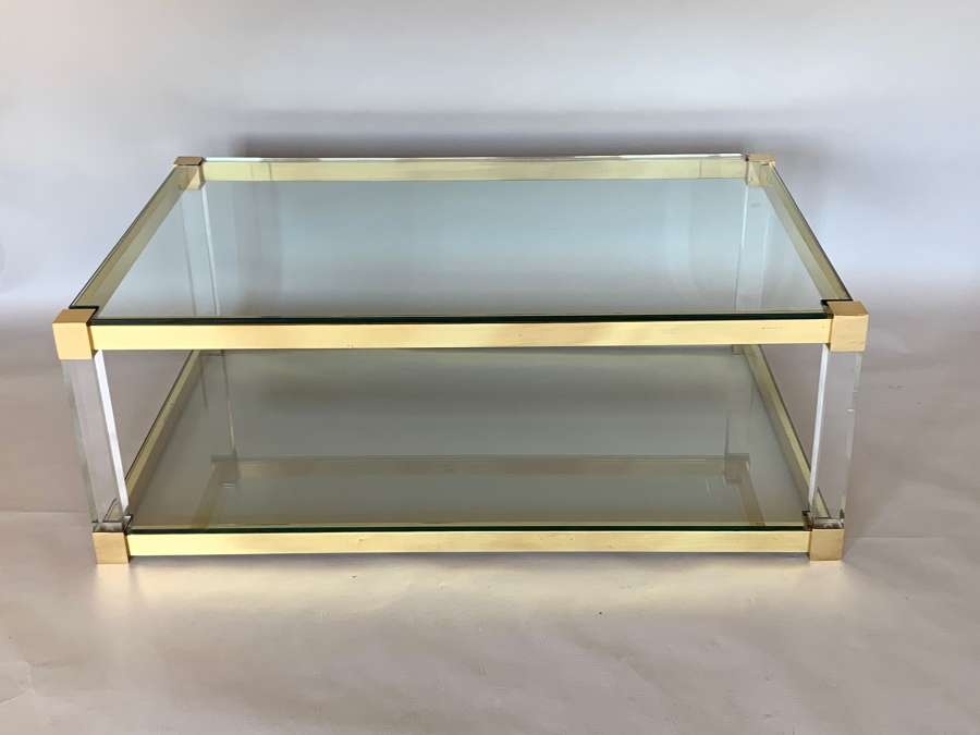 Two tier lucite and brass coffee table